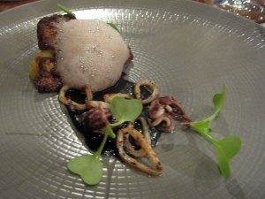 Roasted snow crown with young squid and elderberry vinegar